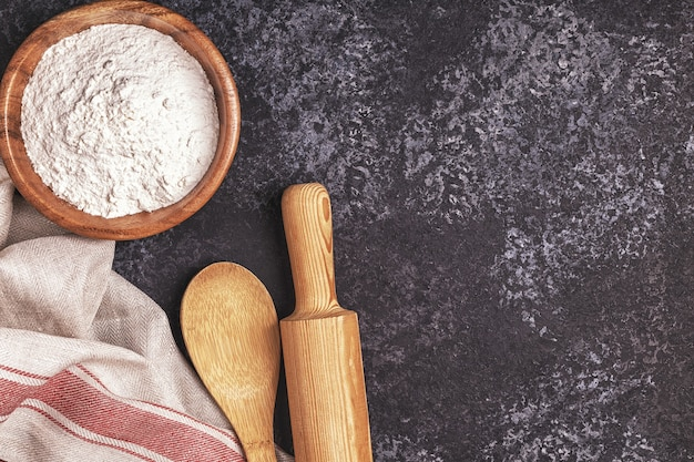 Ingredients for baking  flour, wooden spoon, rolling pin, eggs
