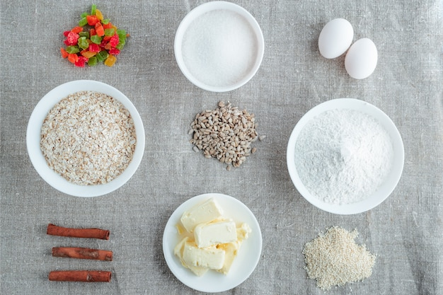Ingredients for baking oatmeal cookies on a light background
