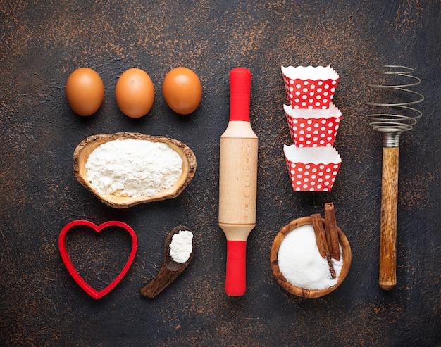 Ingredients for baking on rusty background