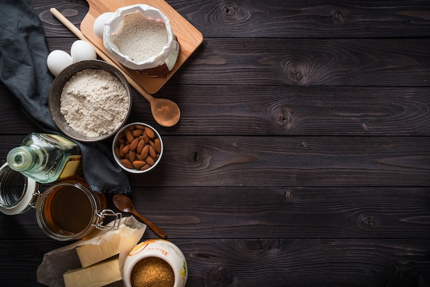 Ingredients for baking on a wooden table, top view