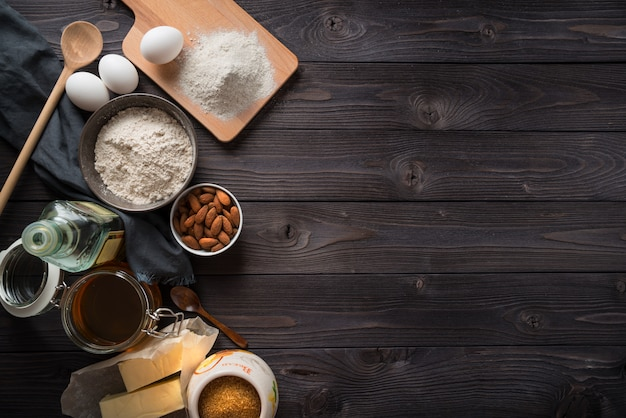 Ingredients for baking on a wooden table top view