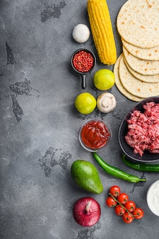 Ingredients for beef meat mexican tacos, corn tortillas, chili pepper, avocado, meat