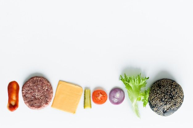Ingredients for the black burger over white background.