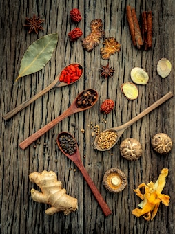 Ingredients for chinese herbal soup on shabby wood