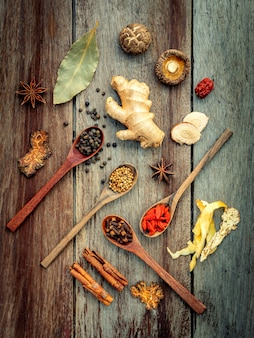 Ingredients for chinese herbal soup on shabby wooden background .
