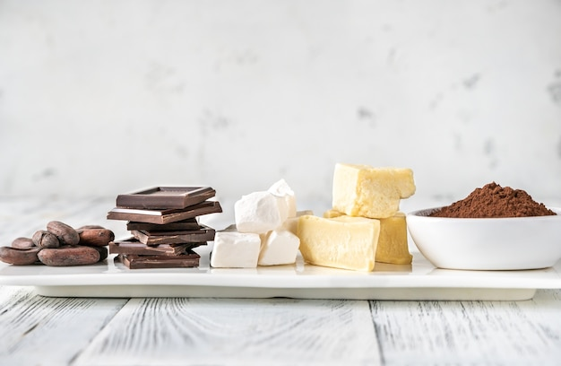 Ingredients of chocolate on white serving plate