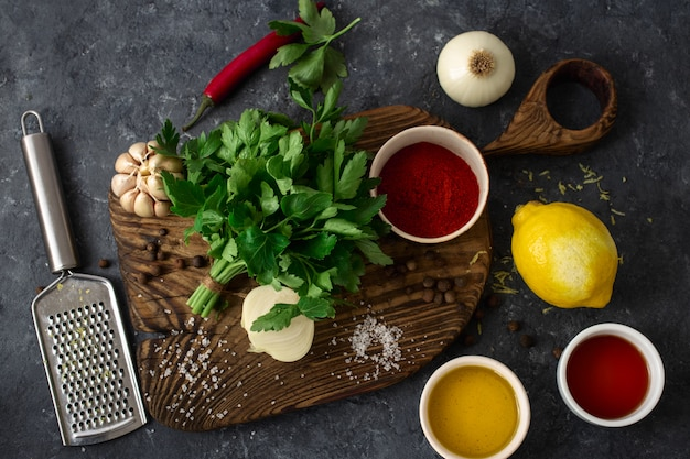 Ingredients for cooking argentinian green chimichurri or chimmichurri salsa