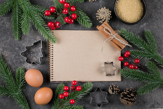 Ingredients for cooking christmas baking, white paper notebook