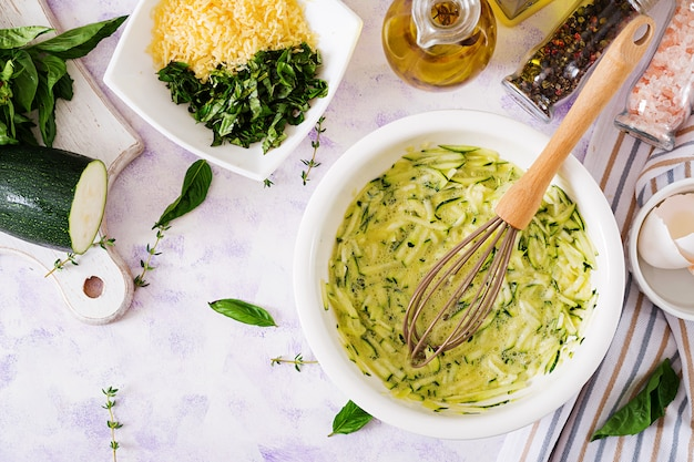 Ingredients for cooking frittata with zucchini, cheese and basil.  italian omelette.
