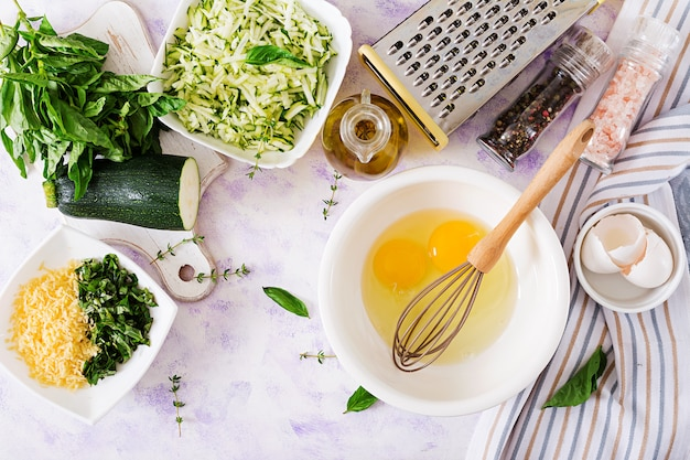 Ingredients for cooking frittata with zucchini, cheese and basil. .