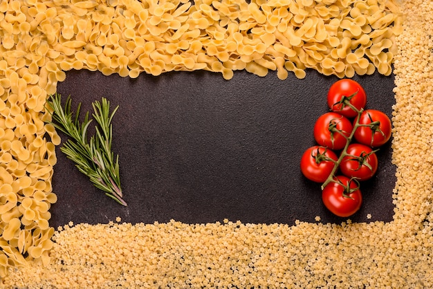 Ingredients for cooking paste. cherry tomatoes, spices and herbs prepared for pasta