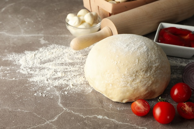 Ingredients for cooking pizza on gray background