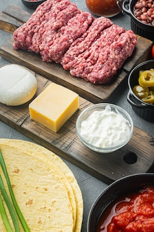 Ingredients for cooking quesadillas, on gray background
