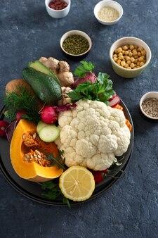 Ingredients cooking vegetarian indian dish aloo gobi top view healthy food