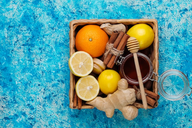 Ingredients: fresh ginger, lemon, cinnamon sticks, honey, dried cloves for making immunity boosting healthy vitamin drink