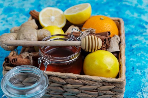 Ingredients: fresh ginger, lemon, cinnamon sticks, honey, dried cloves for making immunity boosting healthy vitamin drink
