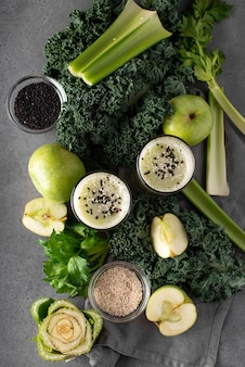 Ingredients for a green smoothie on a gray table