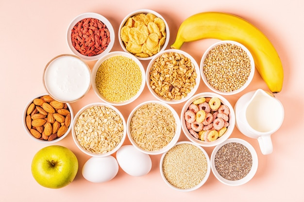 Ingredients for healthy breakfast - cereals, grains, dairy products, seeds, nuts and fruits.