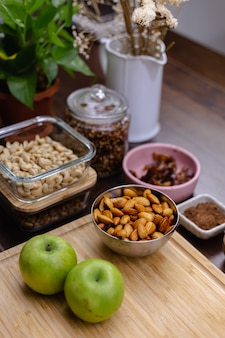 Ingredients for healthy dessert chia puddings in kitchen on wooden table