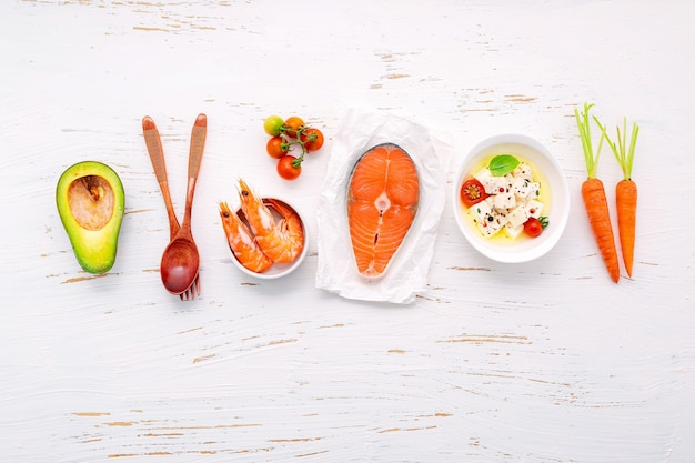 Ingredients for healthy foods selection set up on white wooden background