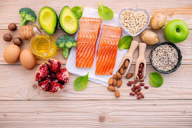 Ingredients for the healthy foods selection set up on wooden background.