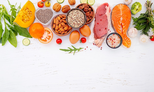 Ingredients for healthy foods selection on white wooden background.