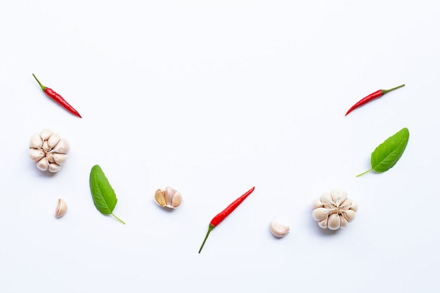 Ingredients herb and spice, holy basil, chili and garlic on white background copyspace