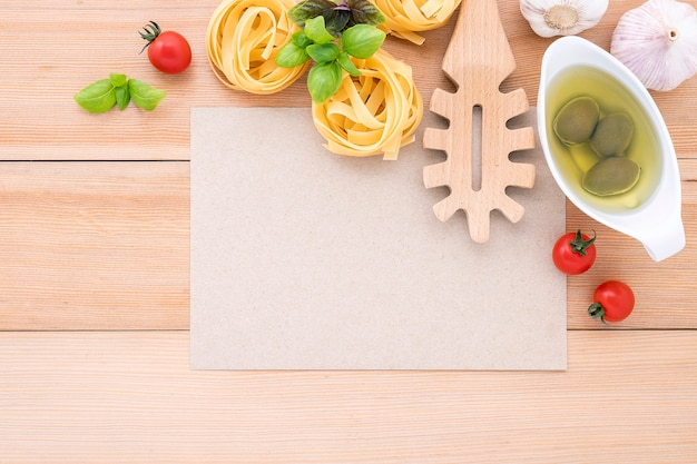 The ingredients for homemade pasta with copy space on wooden table.
