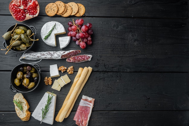 Ingredients for italian  food, meat cheede, herbs set, on black wooden table, flat lay