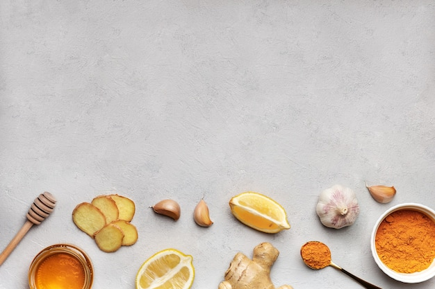 Ingredients for making healthy beverages to support immune system flat lay on gray