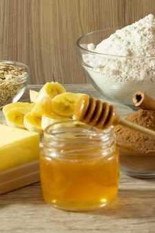 Ingredients for making healthy biscuit. banana, oats's flour, honey, cinnamon and butter.