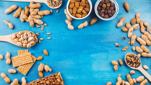 Ingredients for making homemade energy bar on blue textured background