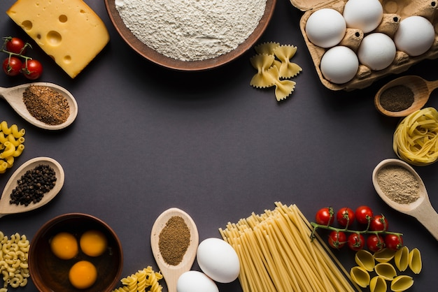 Ingredients for pasta on gray