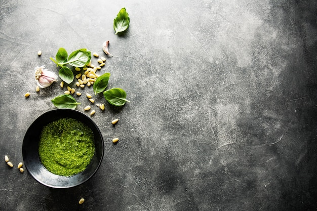 Ingredients for pesto on grey concrete background