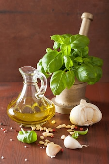 Ingredients for pesto sauce over wooden rustic table