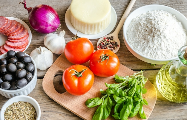 Ingredients for pizza on the wooden table