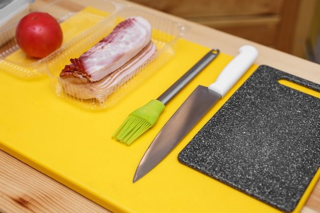 Ingredients prepared on wooden table to cook a sandwich