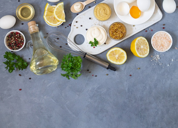 Ingredients for preparing homemade mayonnaise top view with copy space