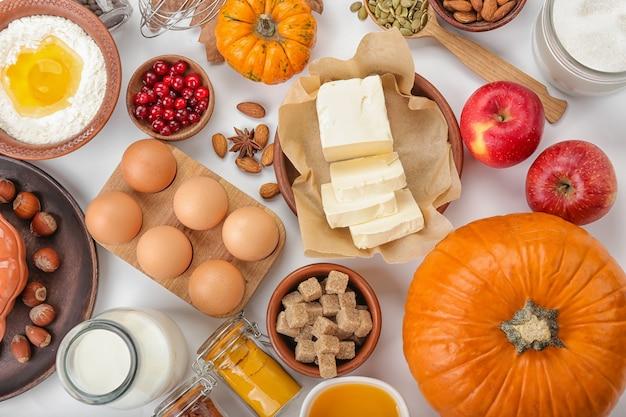 Ingredients for preparing pumpkin pie on white
