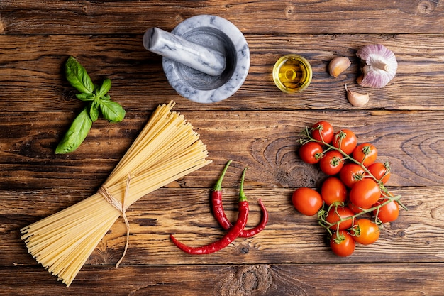 Ingredients for spaghetti bolognaise or bolognese with tomato, basil and spices. italian healthy food background