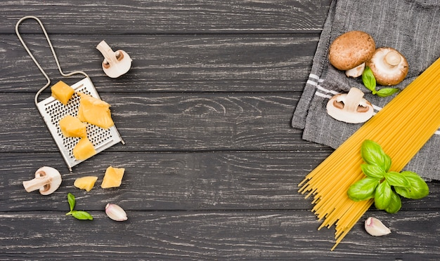 Ingredients for spaghetti with mushrooms on desk