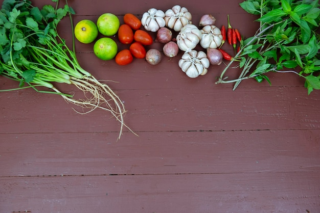 Ingredients for spicy thai soup tom yam on a wooden background