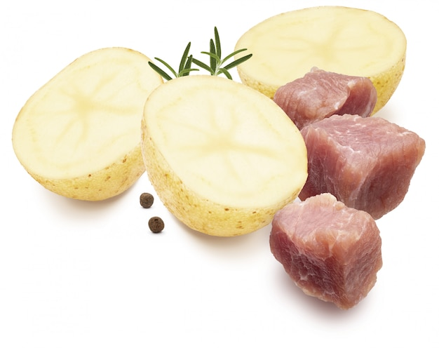 Ingredients for stew. dices of meat, potatoes, black pepper and rosemary. isolated on white