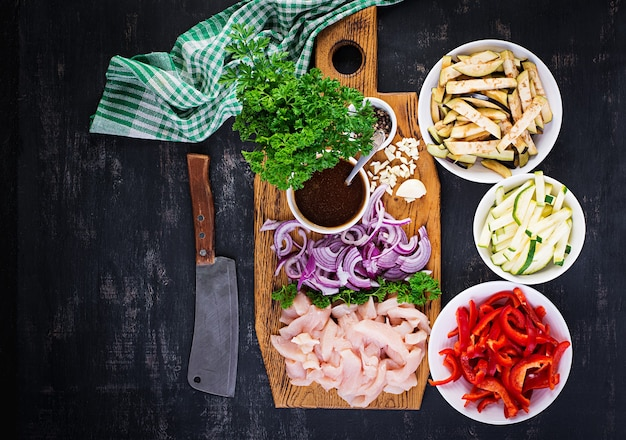 Ingredients for stir fry with chicken, eggplant, zucchini and sweet peppers - chinese food. top view, above