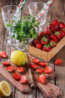 Ingredients for strawberry juice. summer for parties.