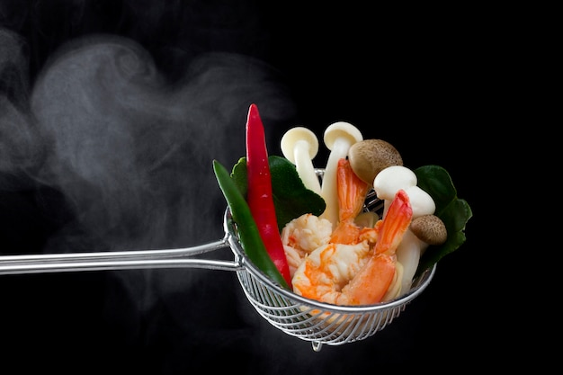Ingredients for thai soup or tom yum goong isolated black background.