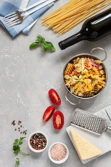 Ingredients for traditional pasta cooking - cheese, tomatoes, condiments.