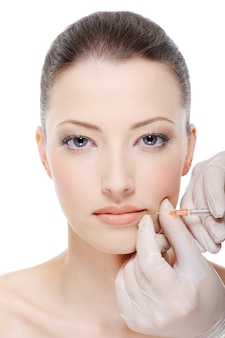 Injection of botox on female lips