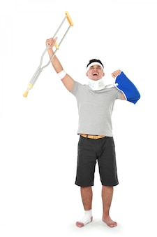 Injured young man hold up his crutch