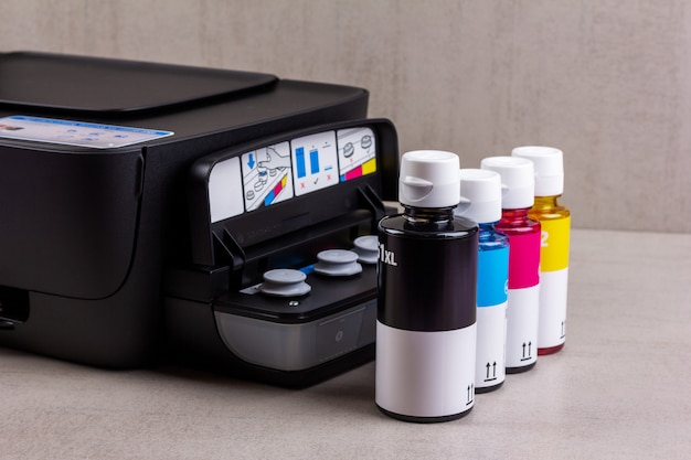Inkjet four-color printer with continuous ink supply and ink bottles for refilling